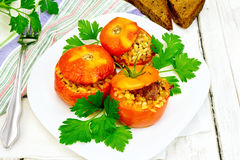 Tomatoes stuffed with bulgur and parsley in plate on table Stock Photography