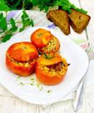 Tomatoes stuffed with bulgur in plate on board Royalty Free Stock Photo