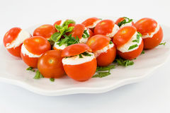 Tomatoes stuffed with cheese Stock Photo