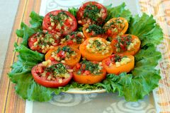 Tomatoes stuffed. With dill, lettuce, peppers and cheese Royalty Free Stock Photography