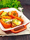 Tomatoes stuffed with rice and meat in brown brazier Stock Images