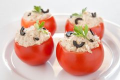 Tomatoes stuffed with tuna and black olives Stock Photos