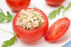 Tomatoes stuffed with tuna salad, bulgur and greens, close-up Stock Image