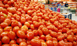 Tomatoes in the supermarket Stock Photos