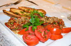 Tomatoes, tabbouleh and bruschette Stock Image