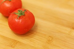 Tomatoes on a table. Fresh and just washed... Royalty Free Stock Image