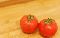Tomatoes on a table. Fresh and just washed... Stock Photos