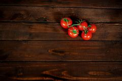 Tomatoes on the table. a place for a label stock photo