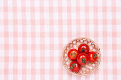 Tomatoes on the table and put it in a basket Stock Image