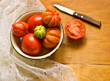 Tomatoes on table Stock Images