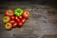 Tomatoes on the table. The tomatoes, typical foods of the Mediterranean diet. The tomato is native to the area of Central America and was Royalty Free Stock Photos