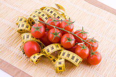 Tomatoes and tailor tape Stock Images