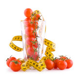 Tomatoes and tailor tape Royalty Free Stock Image