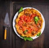 Tomatoes tart tatin on dark wooden background Stock Photo