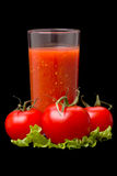 Tomatoes and tomato juice Stock Images