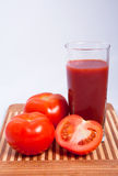 Tomatoes and tomato juice Stock Photo