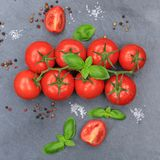 Tomatoes tomato red vegetable square slate top view Stock Images