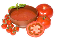 Tomatoes and tomato soup with basil Stock Photos