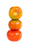 Tomatoes tower. On white background Royalty Free Stock Photos
