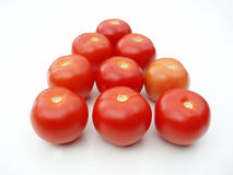 Tomatoes in triangle stock image