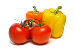 The tomatoes and two peppers Stock Photos