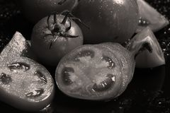 Tomatoes under water drops stock photography