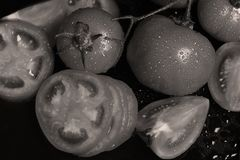 Tomatoes under water drops stock images