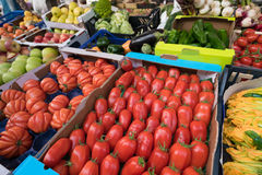 Tomatoes and variety of organic vegetables and fruits in fresh market Royalty Free Stock Photos