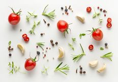 Tomatoes and various herbs and spices. On a white background, top view Royalty Free Stock Images