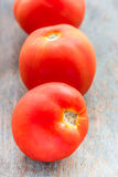 Tomatoes. Vertical image. Fresh  on a wooden base royalty free stock photos