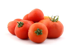 Tomatoes with water droplets Royalty Free Stock Photo