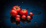 Tomatoes in water Stock Photography