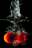 Tomatoes Water Splash. Tomatoes drop in a water tank creating a splash Royalty Free Stock Photo