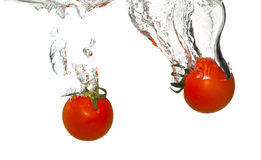 Tomatoes in water splash Royalty Free Stock Photography