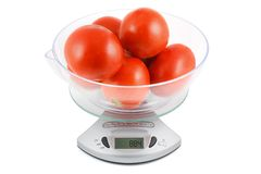Tomatoes are weighed in the balance Stock Photography