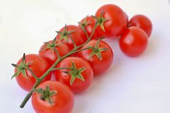 Tomatoes on the white background Stock Photo