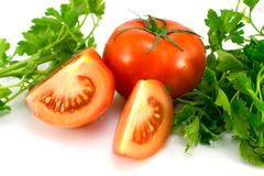 Tomatoes. On a white background with green Stock Photo