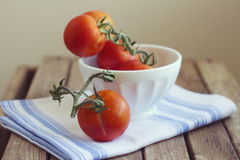 Tomatoes in white bowl Royalty Free Stock Photos