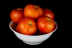 Tomatoes in White Bowl on Black Background Stock Image