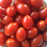 Tomatoes. A white bowl holding small tomatoes Stock Images