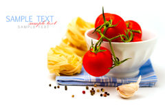 Tomatoes in white bowl and pasta Stock Photography