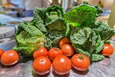 Tomatoes and white cabbage with leaves closeup Stock Images