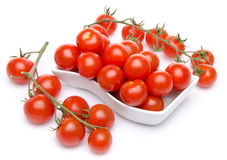 Tomatoes in a white cut and cherry tomatoes stock photography