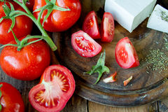 Tomatoes and white greek cheese Royalty Free Stock Photos
