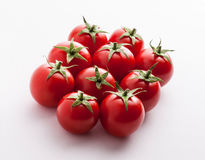 Tomatoes on white. Group of tomatoes on white background Royalty Free Stock Images