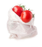 Tomatoes in white paper bag Stock Image