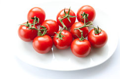 Tomatoes on a white plate. Cherry tomatoes on a white plate Royalty Free Stock Image