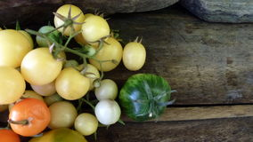 Tomatoes 36. White tomato on old wooden table Stock Photography
