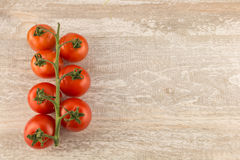 Tomatoes on a white wooden background close up copy space. Stock Photography