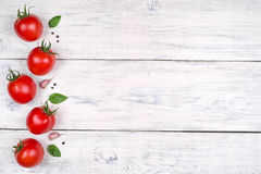 Tomatoes on white wooden table, pasta ingredients top view Stock Image